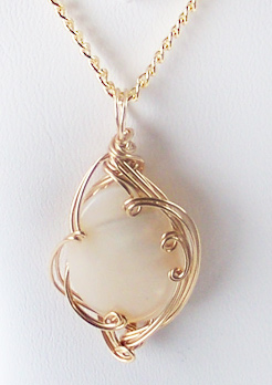 mother of pearl pendant. Mother Of Pearl And Gold Wire Wrapped Pendant (Genuine). Zoom L